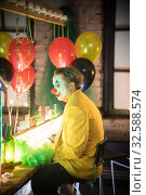 Купить «Clown concept - a bored man in yellow jacket sitting in the dressing room», фото № 32588574, снято 30 октября 2019 г. (c) Константин Шишкин / Фотобанк Лори