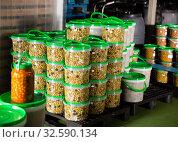 Купить «Stacked plastic buckets with pickled olives», фото № 32590134, снято 25 февраля 2020 г. (c) Яков Филимонов / Фотобанк Лори