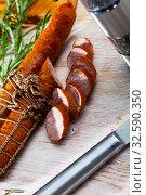 Купить «Lean smoked ham sausage on wooden table», фото № 32590350, снято 10 декабря 2019 г. (c) Яков Филимонов / Фотобанк Лори