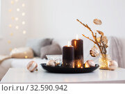black burning candles with Christmas balls in white interior. Стоковое фото, фотограф Майя Крученкова / Фотобанк Лори