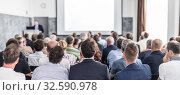 Купить «Business speaker giving a talk at business conference event.», фото № 32590978, снято 30 сентября 2019 г. (c) Matej Kastelic / Фотобанк Лори