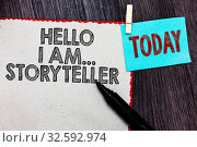Купить «Writing note showing Hello I Am..Storyteller. Business photo showcasing introducing yourself as novels article writer White page red borders marker clothespin reminder wooden background», фото № 32592974, снято 20 февраля 2020 г. (c) easy Fotostock / Фотобанк Лори