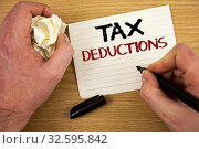 Купить «Handwriting text Tax Deductions. Concept meaning Reduction on taxes Investment Savings Money Returns Text two words white paper note black marker hand crumbled paper note», фото № 32595842, снято 6 августа 2020 г. (c) easy Fotostock / Фотобанк Лори