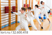 Купить «fencers practicing fencing technique on cushions», фото № 32600418, снято 30 мая 2018 г. (c) Яков Филимонов / Фотобанк Лори
