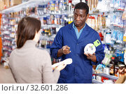 Купить «Competent seller consulting young woman about purchase of supplies for household works in store», фото № 32601286, снято 21 января 2019 г. (c) Яков Филимонов / Фотобанк Лори