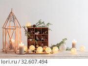 Купить «Christmas decorations on background white wall», фото № 32607494, снято 20 октября 2019 г. (c) Майя Крученкова / Фотобанк Лори