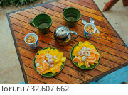 Купить «Hot tea, Fresh Mango, Mangosteen and tangerines on the wooden table», фото № 32607662, снято 19 января 2019 г. (c) Aleksejs Bergmanis / Фотобанк Лори