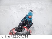 Happy child with an inflatable sled. Стоковое фото, фотограф Юлия Бабкина / Фотобанк Лори
