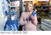 Купить «Woman looking for water in bottles», фото № 32615762, снято 8 февраля 2019 г. (c) Яков Филимонов / Фотобанк Лори