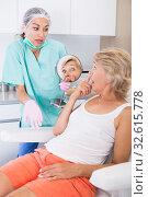 Unhappy woman in clinic of esthetic medicine. Стоковое фото, фотограф Яков Филимонов / Фотобанк Лори