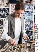 Купить «Seamstress looking for buttons in shop», фото № 32615970, снято 18 октября 2019 г. (c) Яков Филимонов / Фотобанк Лори
