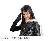 Купить «Portrait of an attractive brunette girl in retro pilot costume giving military salute», фото № 32616694, снято 1 декабря 2019 г. (c) Алексей Кузнецов / Фотобанк Лори