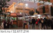Купить «BARCELONA, SPAIN - DECEMBER 1, 2015:  People  walking at Christmas market near Cathedral in evening. Barcelona, Spain.  Kiosks with Traditional Christmas toys and gifts», видеоролик № 32617214, снято 1 декабря 2015 г. (c) Яков Филимонов / Фотобанк Лори