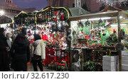 Купить «BARCELONA, SPAIN - DECEMBER 11, 2019:  Fair of  Santa Llucia - Christmas market near Cathedral   in evening. Barcelona, Catalonia.», видеоролик № 32617230, снято 11 декабря 2019 г. (c) Яков Филимонов / Фотобанк Лори