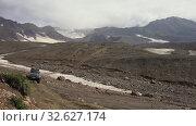 Купить «SUV Nissan Patrol and Mitsubishi Pajero driving on mountain road - popular travel destinations for climbing», видеоролик № 32627174, снято 16 августа 2019 г. (c) А. А. Пирагис / Фотобанк Лори