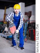Купить «working man practicing his skills with pneumatic drill at workshop», фото № 32627754, снято 17 января 2017 г. (c) Яков Филимонов / Фотобанк Лори