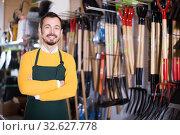 Купить «Male seller demonstrating assortment», фото № 32627778, снято 2 марта 2017 г. (c) Яков Филимонов / Фотобанк Лори