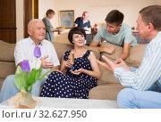 Купить «Happy family gathered in parental home», фото № 32627950, снято 17 августа 2019 г. (c) Яков Филимонов / Фотобанк Лори