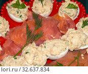 Купить «Red fish and stuffed eggs», фото № 32637834, снято 31 декабря 2012 г. (c) Argument / Фотобанк Лори