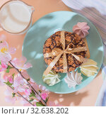 Купить «Fresh baked oatmeal crispy cookies on a blue plate on a background of peach color, milk, French multi-colored meringues. Delicious culinary sweet dessert, romantic festive breakfast, food, snacks», фото № 32638202, снято 30 ноября 2019 г. (c) Светлана Евграфова / Фотобанк Лори