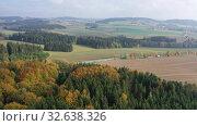 Купить «Picturesque autumn landscape with road between the hills. Czech Republic», видеоролик № 32638326, снято 15 октября 2019 г. (c) Яков Филимонов / Фотобанк Лори