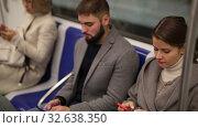 Купить «Man and woman using phone inside subway», видеоролик № 32638350, снято 11 ноября 2019 г. (c) Яков Филимонов / Фотобанк Лори
