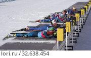 Купить «Sportswoman biathletes in shooting range stadium. Group biathlete aiming, rifle shooting, reloading rifle in prone position. Junior biathlon competitions East of Cup», видеоролик № 32638454, снято 14 апреля 2019 г. (c) А. А. Пирагис / Фотобанк Лори