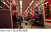 Купить «Interior of modern Prague metro car with traveling people», видеоролик № 32639066, снято 13 октября 2019 г. (c) Яков Филимонов / Фотобанк Лори