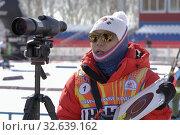 Купить «Coach of South Korea biathlon team instructs biathletes at shooting range of biathlon stadium during Junior biathlon competitions East of Cup», фото № 32639162, снято 14 апреля 2019 г. (c) А. А. Пирагис / Фотобанк Лори