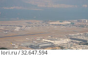 Купить «Aerial view at Chek Lap Kok airport from cable car cabin», видеоролик № 32647594, снято 9 ноября 2019 г. (c) Игорь Жоров / Фотобанк Лори