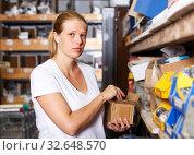 Купить «Female customer in building store», фото № 32648570, снято 20 сентября 2018 г. (c) Яков Филимонов / Фотобанк Лори