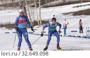 Купить «Kamchatka team sportsman biathletes Smolyakov Danila and Miroshnichenko Maria skiing snow ski track relay race Junior biathlon competitions East of Cup», видеоролик № 32649098, снято 14 апреля 2019 г. (c) А. А. Пирагис / Фотобанк Лори