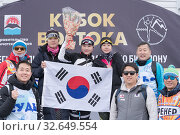 Купить «Korean team of sportswoman biathletes, coaches and sports judges with national flag of South Korea during award ceremony. Junior biathlon competitions East of Cup», фото № 32649554, снято 12 апреля 2019 г. (c) А. А. Пирагис / Фотобанк Лори