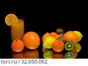 Juicy ripe fruits and drink on a black background. Стоковое фото, фотограф Ласточкин Евгений / Фотобанк Лори