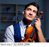 Купить «Young musician man practicing playing violin at home», фото № 32659394, снято 15 августа 2017 г. (c) Elnur / Фотобанк Лори