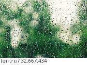 Купить «On transparent glass rain drops flow down. Water Drops, Nature background vintage style», фото № 32667434, снято 28 января 2020 г. (c) easy Fotostock / Фотобанк Лори