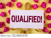 Text sign showing Qualified Motivational Call. Conceptual photo Certified to perform a job Competent Experienced written Sticky Note paper plain background Paper Balls and Wooden Jointed Toy. Стоковое фото, фотограф Zoonar.com/Artur Szczybylo / easy Fotostock / Фотобанк Лори