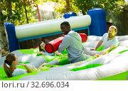Купить «Team of friends playing with inflatable sticks on the trampoline», фото № 32696034, снято 21 февраля 2020 г. (c) Яков Филимонов / Фотобанк Лори