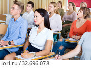 Купить «Portrait of modern young people listening to training session in auditorium», фото № 32696078, снято 9 июля 2020 г. (c) Яков Филимонов / Фотобанк Лори