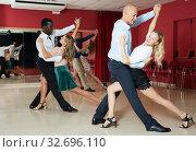 Купить «Couples enjoying latin dances», фото № 32696110, снято 4 октября 2018 г. (c) Яков Филимонов / Фотобанк Лори