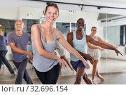 Купить «People dancing lindy hop during group training», фото № 32696154, снято 30 июля 2018 г. (c) Яков Филимонов / Фотобанк Лори
