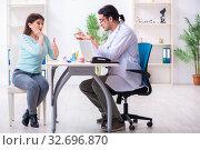 Купить «Middle-aged woman visiting male doctor stomatologist», фото № 32696870, снято 7 марта 2019 г. (c) Elnur / Фотобанк Лори