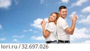 Купить «couple in white t-shirts shirts making gun gesture», фото № 32697026, снято 6 октября 2019 г. (c) Syda Productions / Фотобанк Лори