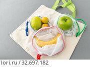 Купить «reusable shopping bags for food with fruits», фото № 32697182, снято 3 мая 2019 г. (c) Syda Productions / Фотобанк Лори
