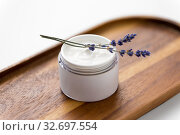 Купить «close up of lavender moisturizer on wooden tray», фото № 32697554, снято 8 ноября 2018 г. (c) Syda Productions / Фотобанк Лори
