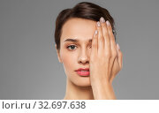 young woman closing one eye with hand. Стоковое фото, фотограф Syda Productions / Фотобанк Лори