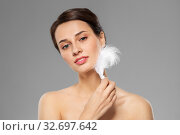 Купить «beautiful woman with feather touching her face», фото № 32697642, снято 30 ноября 2019 г. (c) Syda Productions / Фотобанк Лори