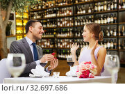 Купить «man making proposal to happy woman at restaurant», фото № 32697686, снято 9 марта 2014 г. (c) Syda Productions / Фотобанк Лори