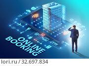 Купить «Concept of online hotel booking with businessman», фото № 32697834, снято 29 февраля 2020 г. (c) Elnur / Фотобанк Лори