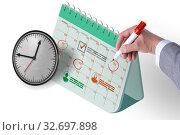 Business calendar concept with businessman. Стоковое фото, фотограф Elnur / Фотобанк Лори